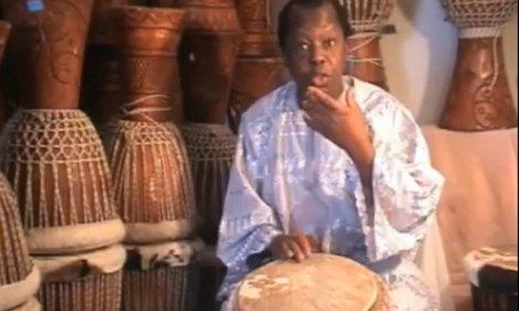 Lamin Jassey teaching djembe
